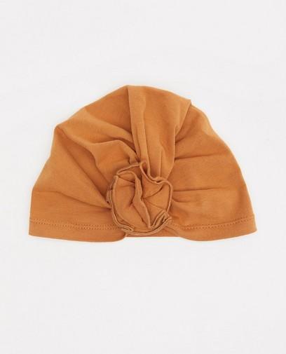 Petit bonnet en coton bio avec une fleur
