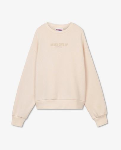 Lichtroze sweater met opschrift Steffi Mercie