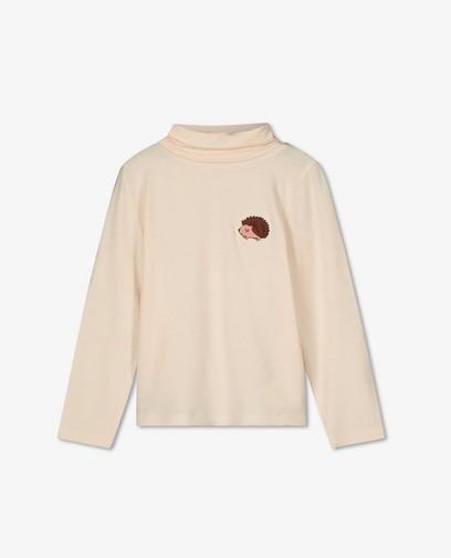 Sous-pull rose pâle avec un écusson